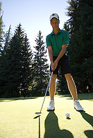 Golfer, male, putts on the Whistler Golf Course, Whistler, BC Canada.