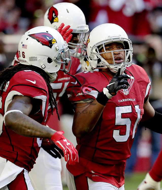 Arizona Cardinals middle linebacker Kevin Minter (51) celebrates his sack against the Washington Redskins during the first half of an NFL football game, Sunday, Dec. 4, 2016, in Glendale, Ariz. (AP Photo/Rick Scuteri)
