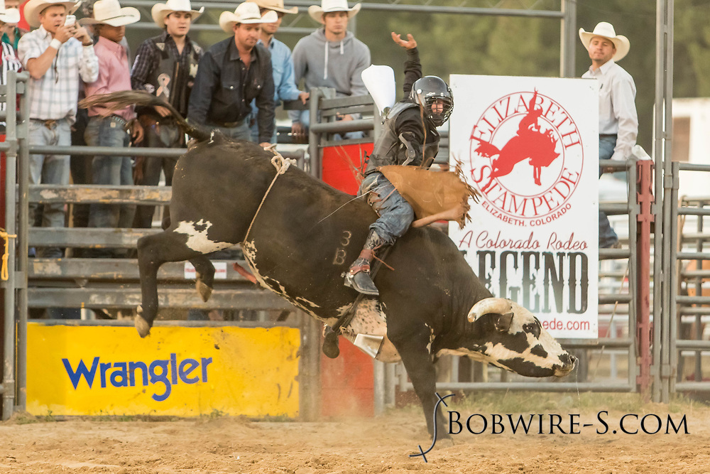 Logan Hunter takes his reride during the Xtreme Bulls event at the Elizabeth Stampede on Friday, June 1, 2018.