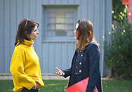 Old Westbury, New York, U.S. October 19, 2019. ISABELA GOLA is outdoors speaking with a visitor at the Closing Reception for Jerzy Kędziora Balance in Nature outdoor sculptures exhibit held at Old Westbury Gardens. Gola, who was a panelist at the event, was born in Poland, and is the Curator of Visual Art & Design Programming at the Polish Cultural Institute NY, in the field of public diplomacy.