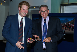 Image ©Licensed to i-Images Picture Agency. 10/06/2014. London, United Kingdom. HRH Prince Harry attends the 50th Anniversary of Zulu premiere. Picture by Anthony Upton / i-Images<br /> Leicester Square, London, 10 June 2014: HRH Pr. Harry with Lord Ashcroft with Lt. Chard VC and Private Robert Jones VC original VC's which were awarded for their actions at Rorke's Drift,  at a gala screening to celebrate the 50th Anniversary of Zulu where guests were joined by Prince Harry to watch a digitally remastered version of the iconic film. The evening was arranged to raise money for two charities supported by Prince Harry, Walking With The Wounded and Sentebale. <br /> For further info please contact<br /> Emily Conrad-Pickle Captive Minds<br /> Mobile: +44 (0)7799 414 790<br /> emily.conrad-pickles@captiveminds.com