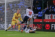 Bolton Wanderers midfielder Neil Danns  challenge Brentford midfielder Alan Judge  during the Sky Bet Championship match between Bolton Wanderers and Brentford at the Macron Stadium, Bolton, England on 30 November 2015. Photo by Simon Davies.