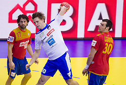 Jure Dolenec of Slovenia between Juan Antonio Garcia of Spain and Gedeon Guardiola of Spain during handball match between Spain and Slovenia in  Main Round of 10th EHF European Handball Championship Serbia 2012, on January 25, 2012 in Spens Hall, Novi Sad, Serbia. (Photo By Vid Ponikvar / Sportida.com)
