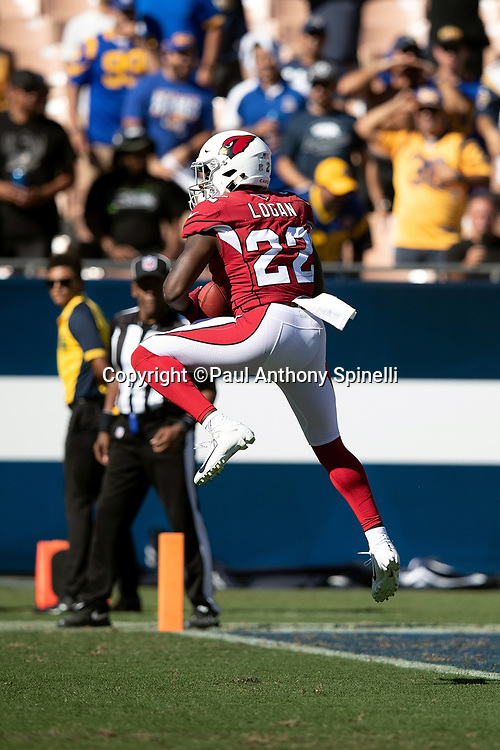 Arizona Cardinals running back T.J. Logan (22) leaps and catches a fourth quarter kickoff during the 2018 NFL regular season week 2 football game against the Los Angeles Rams on Sunday, Sept. 16, 2018 in Los Angeles. The Rams won the game in a 34-0 shutout. (©Paul Anthony Spinelli)