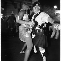 Drag queen meets the skirted macho man of Scotland on the streets of Greenwich Village, during Halloween, in NYC.