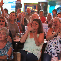 Area residents cheer on performers during the New Expectations for Women in Mississippi (NEWMS), a special project of the CREATE Foundation Lip Synce Battle Tuesday night at Steele's Dive in Tupelo. The event was held as a fund aiser which assists women and children who can't be helped by other organizations.