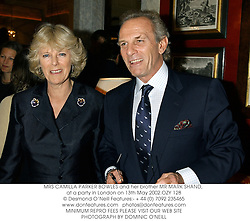 MRS CAMILLA PARKER BOWLES and her brother MR MARK SHAND, at a party in London on 13th May 2002.	OZY 128