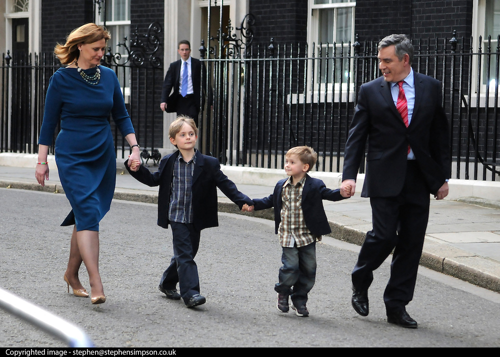 © under license to London News Pictures. 11/05/10. Gordon Brown, his wife Sarah, children John and James walk along Downing Street to a waiting car on the evening of Gordon Brown's resignation as Prime Minister. British Prime Minister Gordon Brown has resigned his position and David Cameron has become the new British Prime Minister on May 11, 2010. The Conservative and Liberal Democrats are to form a coalition government after five days of negotiation. Photo credit should read Stephen Simpson/LNP