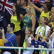Swimming - Olympics: Day 1 Australian supporters cheer for  Emma McKeon, Brittany Elmslie, Bronte Campbell and Cate Campbell, at the medal presentation for winning the gold medal in world record time in the Women's 4 x 100m Freestyle Relay Final during the swimming competition at the Olympic Aquatics Stadium August 6, 2016 in Rio de Janeiro, Brazil. (Photo by Tim Clayton/Corbis via Getty Images)