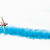 Picture by Christian Cooksey/CookseyPix.com on behalf of South Ayrshire Council. <br /> All rights reserved. For full terms and conditions see www.cookseypix.com<br /> <br /> The Scottish Airshow 2015, Ayr, South Ayrshire.<br /> <br /> Two Red Arrows move to pass close together.