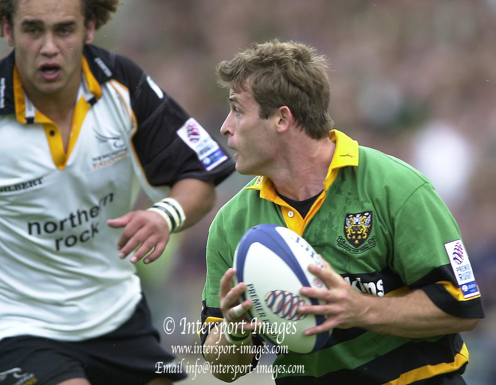 Photo Peter Spurrier.07/09/2002.Zurich Premiership - Northampton vs Newcastle.Saints Orial Ripol loo's for support as Soa Otuvaka moves in for the tackle...