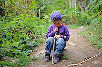 Boy, 3, sits on rock to pout about hiking the Cheakamus trail near Whistler, BC, Canada.