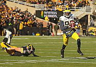 November 23 2013: Michigan Wolverines quarterback Devin Gardner (98) looks down field as he rolls out with the ball during the second quarter of the NCAA football game between the Michigan Wolverines and the Iowa Hawkeyes at Kinnick Stadium in Iowa City, Iowa on November 23, 2013. Iowa defeated Michigan 24-21.