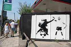© Licensed to London News Pictures. 06/07/2018. London, UK. A street art mural depicting Spanish tennis player Rafael Nadal being robbed of his £550,000 Richard Mille RM27-03 wrist watch by a moped gang is on a wall in Southfields, near Wimbledon All England Lawn Tennis and Croquet Club during the tennis championships. The mural is signed #Fussy Human. Photo credit: Ray Tang/LNP