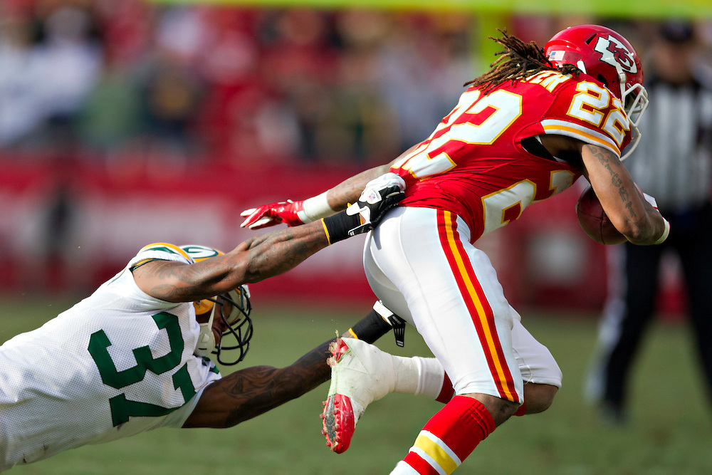 KANSAS CITY, MO - DECEMBER 18:   Dexter McCluster #22 of the Kansas City Chiefs is grabbed from behind by Sam Shields #37 of the Green Bay Packers at Arrowhead Stadium on December 18, 2011 in Kansas CIty, Missouri.  The Chiefs defeated the Packers 19-14.   (Photo by Wesley Hitt/Getty Images) *** Local Caption *** Dexter McCluster; Sam Shields