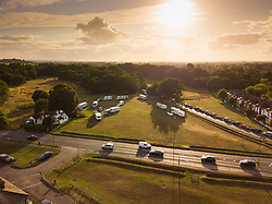 MailOnline<br /> Travellers move into a new camp in Weston Green, taking over a picturesque village green adjacent to a golf course. Weston Green, Surrey, August 16 2018.