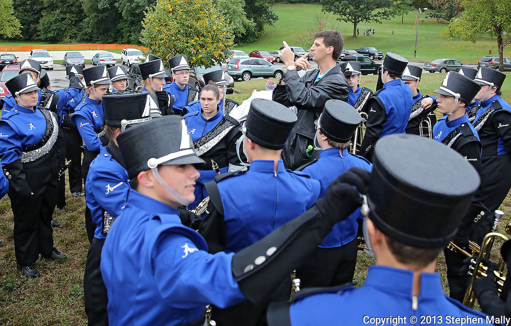 Anamosa Blue Raider Marching Band director Mike Meyer talks with his band before the start of the 33rd Annual Marion Marching Invitational at Thomas Park Field in Marion on Saturday, September 28, 2013.