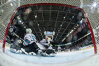 KELOWNA, CANADA - APRIL 17: Michael Herringer #30 of Kelowna Rockets defends the net and makes a save against the Victoria Royals on April 17, 2016 at Prospera Place in Kelowna, British Columbia, Canada.  (Photo by Marissa Baecker/Shoot the Breeze)  *** Local Caption *** Michael Herringer;