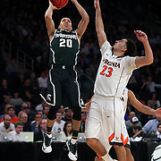 Travis Trice, Michigan State, drives to the basket while defended by London Perrantes, Virginia,  during the Virginia Cavaliers Vs Michigan State Spartans basketball game during the 2014 NCAA Division 1 Men's Basketball Championship, East Regional at Madison Square Garden, New York, USA. 28th March 2014. Photo Tim Clayton