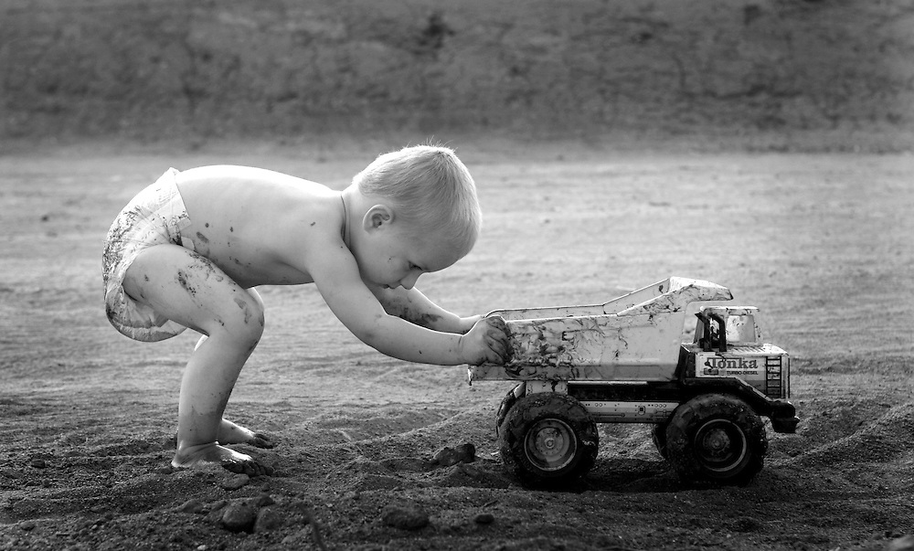 artistic temecula childrens photographer captures boy with truck at play in black 7 white