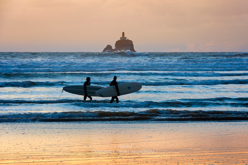 Surfers and Tillamook Rock Light House, Oregon.