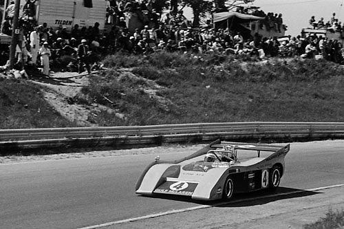 Peter Revson in  McLaren M20 at the 1972 Mosport Can-Am, note tape covering name of original driver Jackie Stewart on front fender; Photo by Gerald Schmitt 1972/ © 2014 Pete Lyons / petelyons.com
