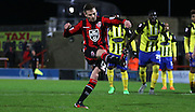 Paul Mullin scores during the Sky Bet League 2 match between Morecambe and Dagenham and Redbridge at the Globe Arena, Morecambe, England on 1 December 2015. Photo by Pete Burns.