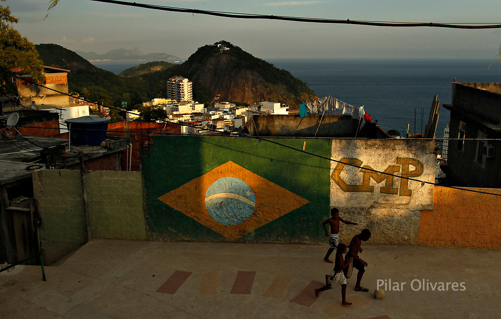 Children play soccer at a square in Babilonia favela in Rio de Janeiro February 22, 2013.