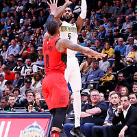 09 April 2018: Denver Nuggets forward Will Barton (5) takes a jump shot over Portland Trail Blazers guard Damian Lillard (0) during the Denver Nuggets 88-82 victory over the Portland Trail Blazers, at the Pepsi Center, Denver, Colorado, USA.