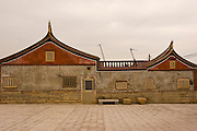 Traditional southern Chinese architecture on Kinmen, Republic of China ROC (Taiwan). ..Kinmen (Jinmen) formely known as Quemoy. The island lies less than 2km off the coast of China, and in 1949 was turned into a front-line of defense for Taiwan by Chiang Kai-shek and the Chinese nationalist Kuomintang (KMT) in the ongoing war with the communist PRC. The island existed under martial law until 1993. Today, Kinmen is a popular tourist destination and home to a lot of traditional Fujian-style architecture.