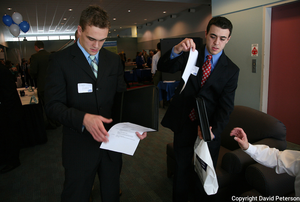 Students at Drake University hand over their reseme' s at the Business School's Career Day.  Students met with various businesses and industries, looking at prospective jobs and internships... The private University in Des Moines, Ia., has been lauded for it's outstanding programs in the arts in addition to having one of the best law schools and pharmacy departments in the country.