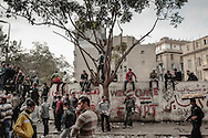 Protesters stand by on Mohamed Mahmoud street near Tahrir Square during stand off  with riot police on November 24, 2011 in Cairo, Egypt.