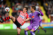 Exeter City's David Wheeler and Plymouth Argyle's Gary Sawyer during the Sky Bet League 2 match between Exeter City and Plymouth Argyle at St James' Park, Exeter, England on 2 April 2016. Photo by Graham Hunt.