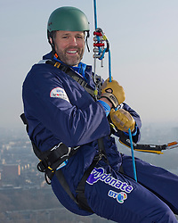 In the frame - Martin Bayfield begins his abseil down BT Tower.<br /> <br /> A 30 strong team of celebrities, serving Royal Marines and BT Employees will today abseil, for only the third time ever, from the 31st floor of the iconic BT Tower, raising money for Sports Relief and the Royal Marines Charitable Trust.  The event also marks the launch of the 350th Anniversary celebrations of the Royal Marines, the BT Tower, London, United Kingdom. Monday, 10th March 2014. Picture by Anthony Upton / i-Images