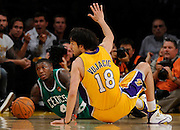 Celtics Nate Robinson and Lakers Sasha Vujacic battle for the ball in the first half. The Lakers defeated the Boston Celtics in game 6 of the NBA Finals 89-67. Los Angeles, CA 06/15/2010 (John McCoy/Staff Photographer).