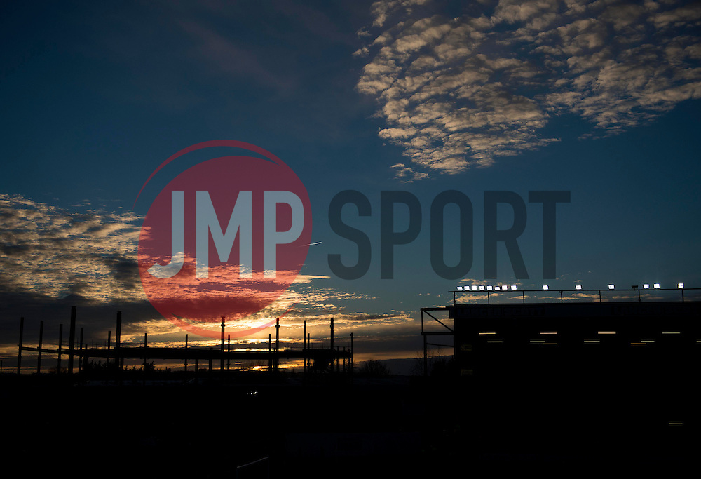 The sun sets behind the silhouette of the new South Stand  - Photo mandatory by-line: Joe Meredith/JMP - Mobile: 07966 386802 - 22/11/2014 - Sport - Football - Bristol - Ashton Gate - Bristol City v Preston North End - Sky Bet League One