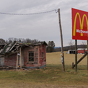 A dilapidated structure stands next to a McDonalds advertising billboard. Somewhere near Luray, VA