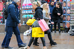 © Licensed to London News Pictures. 23/12/2018. London, UK. A woman with shopping bags on Oxford Street. Last minute Christmas shoppers take advantage of pre-Christmas bargains in London's Oxford Street. Fewer shoppers have been reported shopping in Britain's high streets as online sales increase. Photo credit: Dinendra Haria/LNP