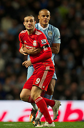 03.01.2012, Etihad Stadion, Manchester, ENG, PL, Manchester City vs FC Liverpool, 19. Spieltag, im Bild Liverpool's Andy Carroll is held back by Manchester City's Vincent Kompany // during the football match of English premier league, 19th round, between Manchester City and FC Liverpool at Etihad Stadium, Manchester, United Kingdom on 2012/01/03. EXPA Pictures © 2012, PhotoCredit: EXPA/ Propagandaphoto/ David Rawcliff..***** ATTENTION - OUT OF ENG, GBR, UK *****