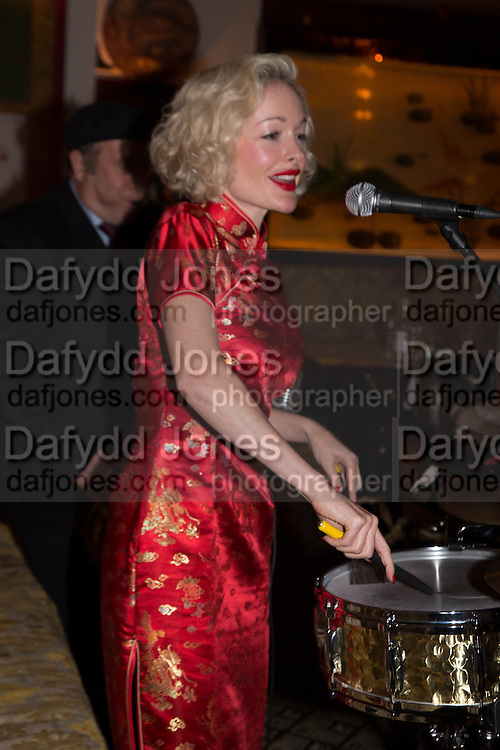 CABARET SINGER KITTY LAROAR, Dinner in aid of the China Tiger Revival hosted by Sir David Tang and Stephen Fry  at China Tang, Park Lane, London. 1 October 2013. ,