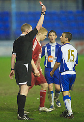 BIRKENHEAD, ENGLAND - Thursday, March 25, 2010: Wigan Athletic's Steven Boothman is shown the red card and sent off by referee Rob Merchant during the FA Premiership Reserves League (Northern Division) match against Liverpool at Prenton Park. (Photo by David Rawcliffe/Propaganda)