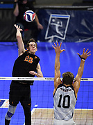 Princeton Tigers outside hitter Parker Dixon (22) hits the ball against Pepperdine Waves outside hitter Michael Wexter (10) during an NCAA Championships opening round match, Wednesday, April 30, 2019, in Long Beach, Calif. Pepperdine defeated Princeton 25-23, 19-25, 25-16, 22-25, 15-8.