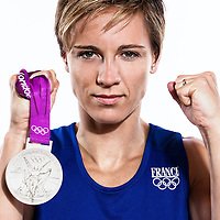 14 August 2012:  Olympic Silver Medalist Celine Dumerc (Team France Basketball) poses with her silver medal, at the Hotel Concorde Lafayette, in Paris, France.