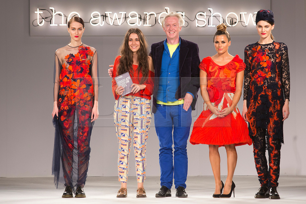 © Licensed to London News Pictures. 03/06/2014. London, England. Grace Weller from Bath Spa University not only scooped the womenswear award but also the George Gold Award. With Philip Treacy and Zoe Hardman. Graduate Fashion Week 2014 concludes with the awards show at the Old Truman Brewery in London, United Kingdom. Photo credit: Bettina Strenske/LNP