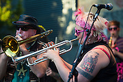 Trumpeter and trombonist, March Fourth Marching Band, Bumbershoot 2011, Seattle, Washington, USA