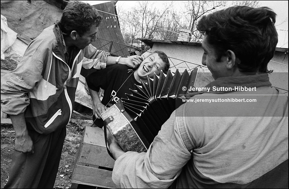 PLAYING MUSIC FOR THE ROMANIAN ORTHODOX EASTER CELEBRATIONS. SINTESTI, ROMANIA, EASTER 1995..©JEREMY SUTTON-HIBBERT 2000..TEL./FAX. +44-141-649-2912..TEL. +44-7831-138817.