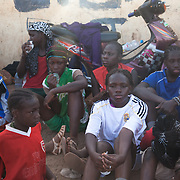 The football youth team of Amazones of Bakodjikoronì, watching the training of the the first team