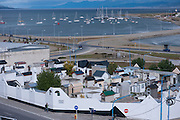 The town cemetery of Ushuaia, the provincial capital of Tierra del Fuego, with sailboats moored in the distance. Tierra del Fuego, Argentina.