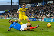 Ben Purrington (3) of AFC Wimbledon is tackled by Anton Walkes (2) of Portsmouth during the EFL Sky Bet League 1 match between Portsmouth and AFC Wimbledon at Fratton Park, Portsmouth, England on 1 January 2019.