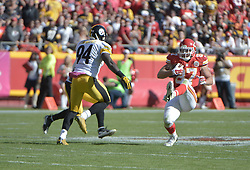 Oct 25, 2015; Kansas City, MO, USA; Kansas City Chiefs tight end Travis Kelce (87) catches a pass and is chased by Pittsburgh Steelers inside linebacker Lawrence Timmons (94) during the second half at Arrowhead Stadium. The Chiefs won 23-13. Mandatory Credit: Denny Medley-USA TODAY Sports